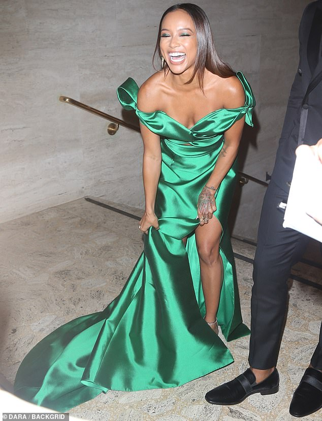 Radiant:The star-studded guest list included Claws star Karrueche Tran, who flashed her midriff in an off-the-shoulder emerald peekaboo gown