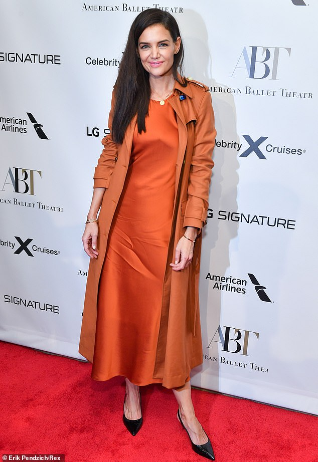 Swank:The All We Had director threw on a flowing burnt-orange jacket with a bit of sheen, slipping into a brighter dress that faintly resembled a nightie