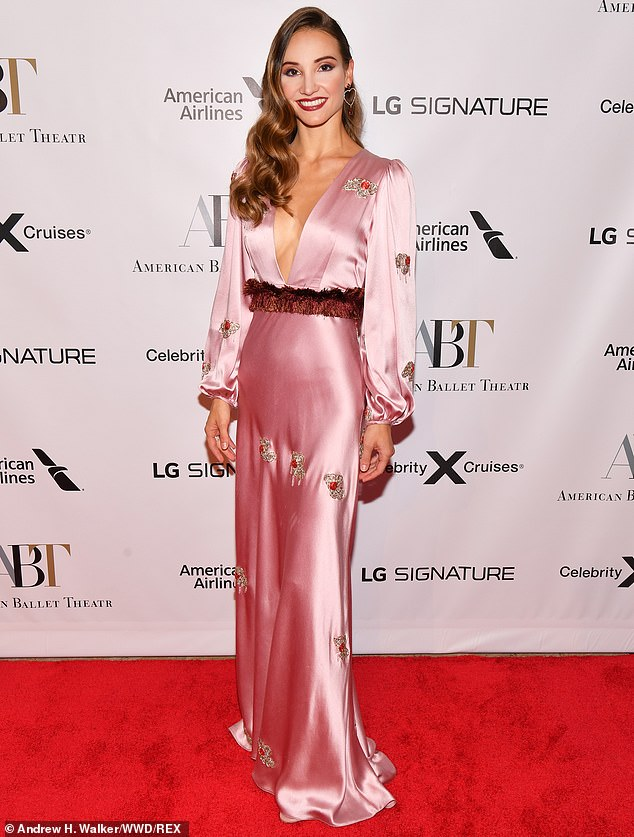 Throwback glamour:Ballerina Christine Shevchenko went for Old Hollywood chic in a shimmering pink gown with a plunging neckline and flowing sleeves that cinched in at the cuff