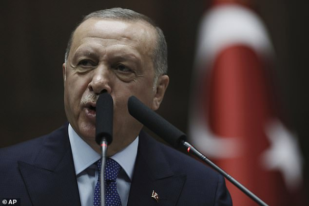 'We would stop the operation tonight, if they withdrew right away,' Erdogan told parliament in Ankara, calling on them to 'lay down their arms ... destroy all their traps and get out of the safe zone that we have designated'