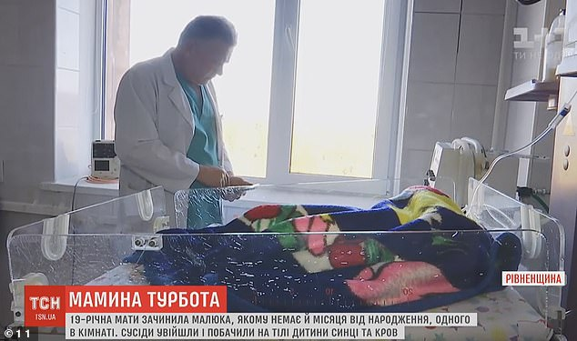 Newborn babyMykyta pictured (above) being treated by medics in intensive care at a hospital inRivne, Ukraine