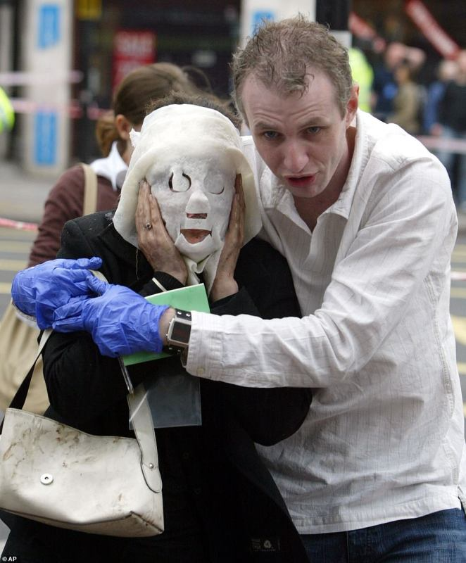 Paul Dadge (right) helping injured tube passenger Davinia Turrell away from Edgware Road tube station in London following an explosion on July 7, 2005. The explosion destroyed a double-decker bus in central London during rush hour followed by two other blasts on other buses. The explosion near Russell Square occurred not long after blasts on the London tube. A witness said the entire top deck of that bus was destroyed. This picture got 18 per cent of the vote