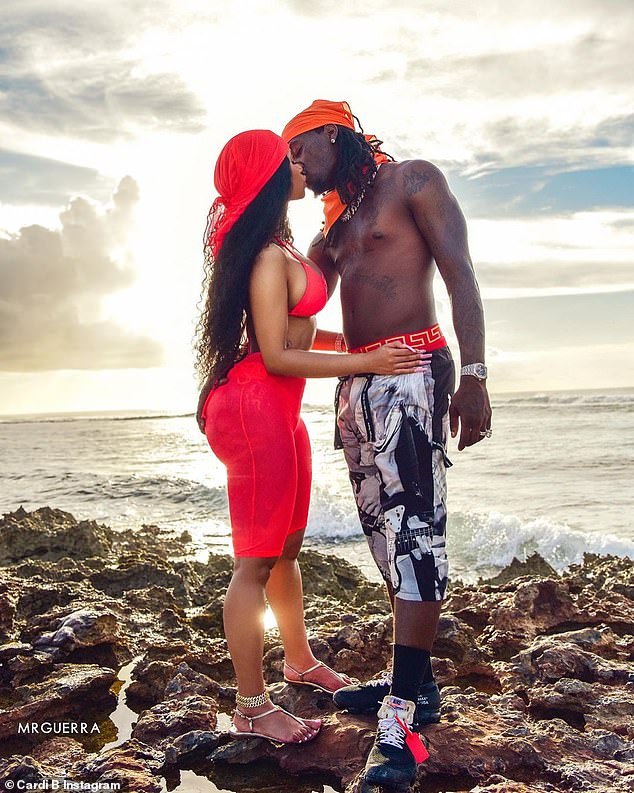 Love is in the air:Cardi B appeared to be completely in love with her husband Offset as she shared a photo of the couple kissing while on holiday