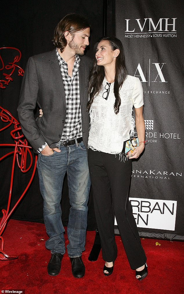 The way they were: Ashton and then wife Demi Moore at an event in 2011 in NYC. She has recently dished the dirt on their eight-year marriage, which ended in 2013, in her book