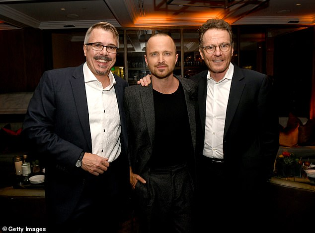 Mystery: El Camino appeared to generate a palpable anticipation in the months before its debut due, in part, to creator Vince Gilligan's (left) desire to keep the production under wraps to avoid any spoilers from going public; Aaron Paul and Bryan Cranston are also pictured