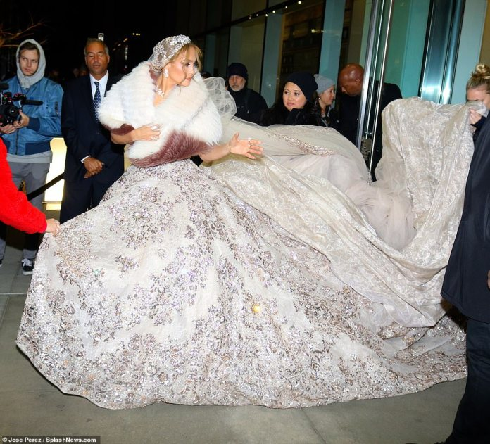Here comes the bride! Jennifer Lopez, 50, stunned in an extravagant white bridal gown while filming a wedding scene for her new movie Marry Me in Manhattan, New York, on Thursday night