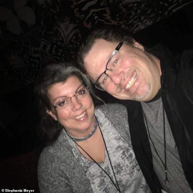 Speaking of juggling two different lives, Stephania (pictured with Michael at a Jason Bonham concert in 2018) explained: 'It was incredibly difficult to maintain both worlds - one predictable and routine,the other exciting and adventurous'