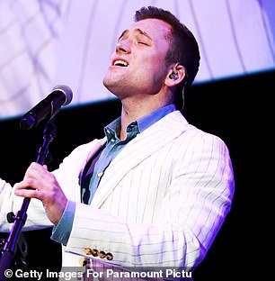 Showman: Taron also took to the stage along with Elton himself to sing (I'm Gonna) Love Me Again