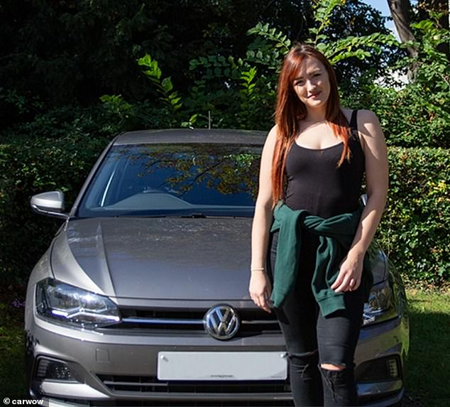 However, it isn't all bad news for those with the more humble vehicle as relationship expert Tracey Cox suggests it shows the driver is 'grounded'. Unidentified woman standing in front of aVolkswagen Polo
