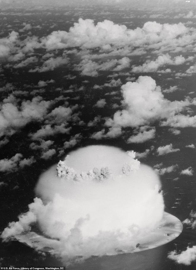 This startling image shows a U.S hydrogen-bomb test in 1946 at Bikini Atoll, Marshall Islands, in the Pacific Ocean. The event, the book says, marked the start of a series of 23 atomic and hydrogen bomb blasts carried out by the U.S government during the 1950s and 60s. It adds: 'This aerial photograph... gives an indication of the vast and almost unimaginable scale of the blast'