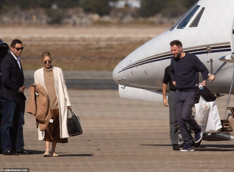 Jennifer Lawrence steps off private jet with groom Cooke Maroney