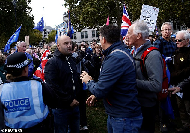 Elsewhere, two men on opposing sides were pictured clashing as the counter-protest moved on to the People's Vote rally turf on Parliament Square Gardens