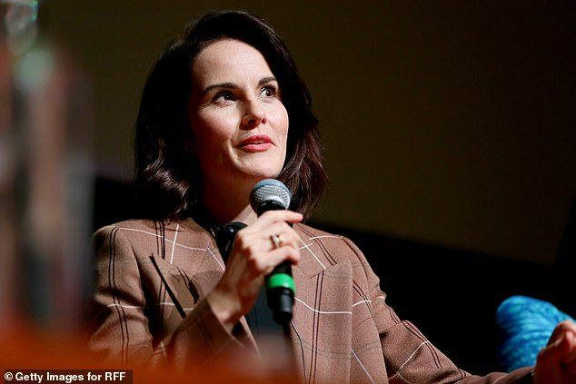 Good spirits: At the panel Michelle reflected on her role in the acclaimed period drama, where she plays Lady Mary Crawley