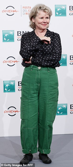 Relaxed: Imelda cut a stylish figure as she opted for the forest green trousers