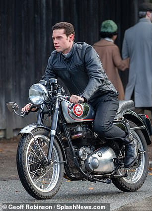Turning heads: The actor caught the eye as he zipped through the quiet village