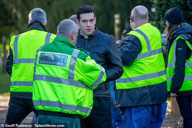 On set: The star was surrounded by ambulance crew as he filmed scenes
