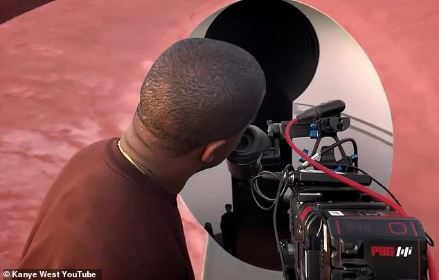 Lining it up: He is presumably lining up the shot outside the crater that was featured in the Jesus Is King trailer ¿ a long slow zoom outside the crater tunnel, looking in