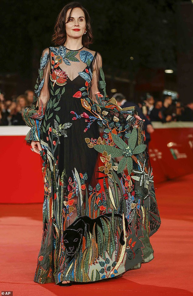 Magnificent: The actress was the envy of the event in a partially see-through maxi dress featuring a jungle scene. A looming jaguar prowled on the fabric near the hem of her skirt