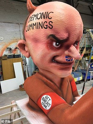 One group of protesters pulled a float depicting key Downing Street aide Dominic Cummings in what seemed to be a Nazi uniform with an armband reading 'Get Brexit Done' and depicting Johnson as his puppet