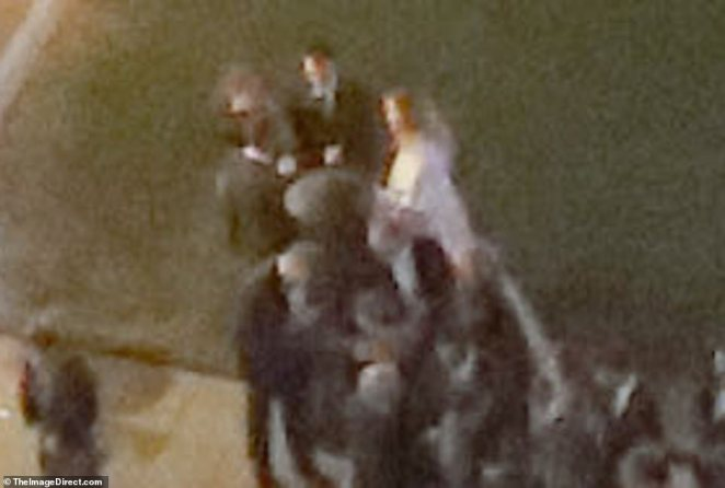 The 29-year-old Oscar winning actress wore a Dior dress as she married the 34-year-old art dealer, People reports (pictured; it appears to be Jennifer, dressed in white, in the courtyard of the venue)