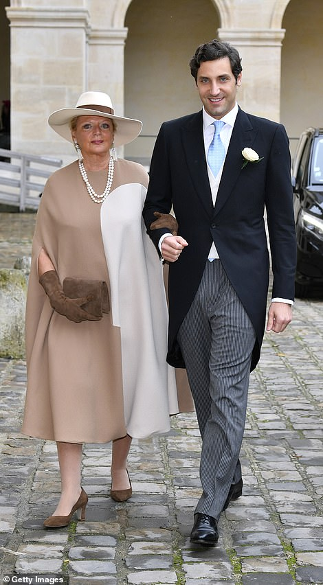 Princess Béatrice de Bourbon Siciles walks into the cathedral with her son Prince Jean-Christophe Napoleon