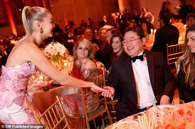 Mr. Jho Low is pictured meeting supermodel Gigi Hadid while attending the Angel Ball hosted by Gabrielle's Angel Foundation at Cipriani Wall Street in 2014