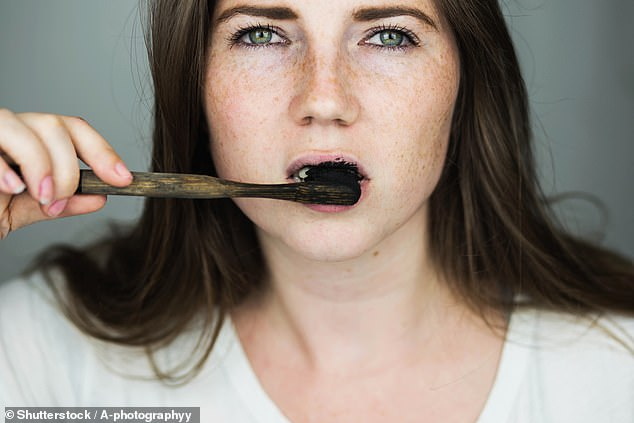 Charcoal toothpaste may not contain fluoride, a mineral which is essential for healthy teeth (stock image)