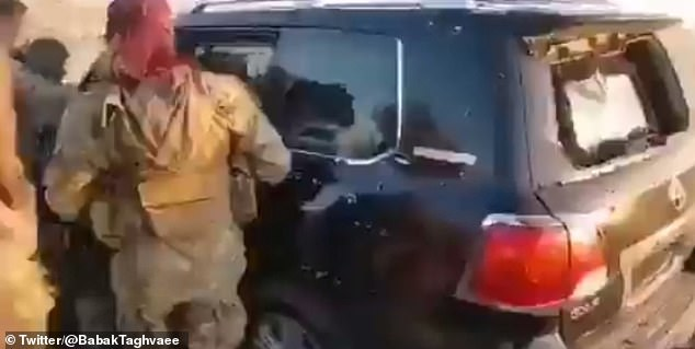 Members of the Turkish-backed militia can be seen pulling a number of the unarmed civilians from the car which has clearly been hit by a barrage of bullets