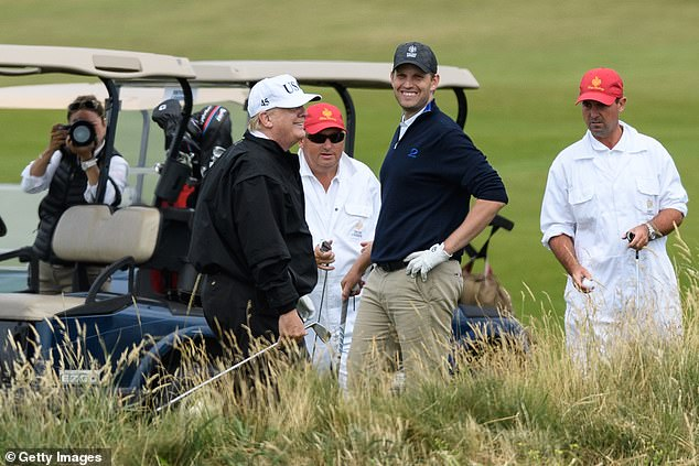 President Donald Trump (CL) and son Eric Trump (CR) play golf at Trump Turnberry Luxury Collection Resort during the President's first official visit to the United Kingdom on July 14, 2018 in Turnberry, Scotland