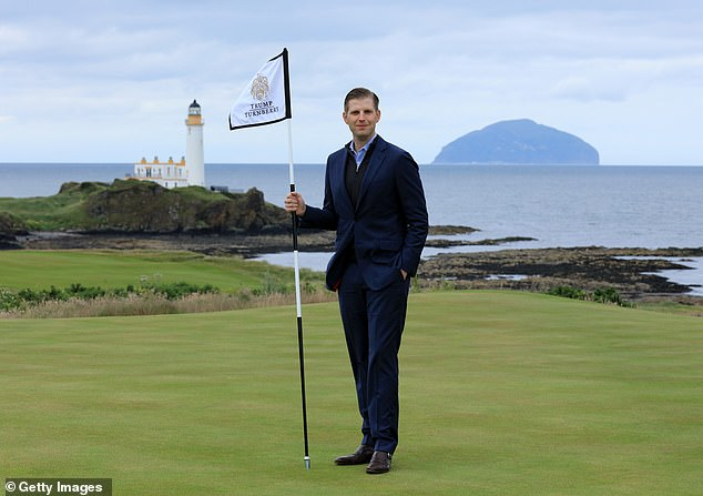 Eric Trump the EVP of the Trump Organization stands on the new 8th green with the Turnberry Lighthouse and the island of Ailsa Craig in the distance during the official opening of the King Robert the Bruce Course at Trump Turnberry Scotland on June 28, 2017 in Turnberry, Scotland