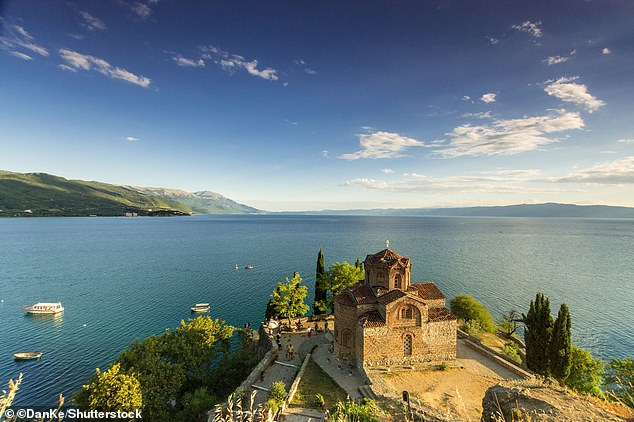 North Macedonia takes third place in the country ranking, with Lonely Planet highlighting the recently launched High Scardus Trail, a 495km (306-mile) trek along the region's most dramatic peaks, as one of the best attractions. Pictured is the country's Lake Ohrid