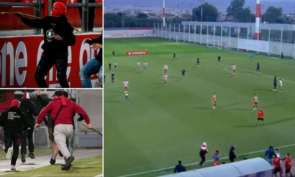 Olympiacos hooligans storm pitch and attack Bayern fans in youth game