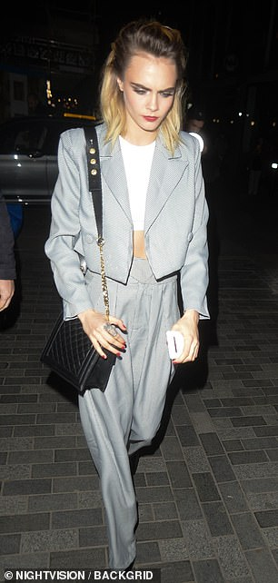 Style maven: Cara continued to match her look by wearing bright red nail polish