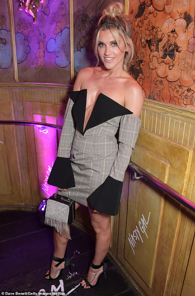 Plunging:Ashley Roberts showed off a glimpse of her cleavage in an asymmetrical dress