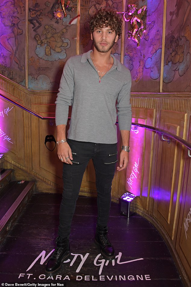 Dapper: The Love Islander opted for a casual chic look as he wore a grey shirt with black jeans