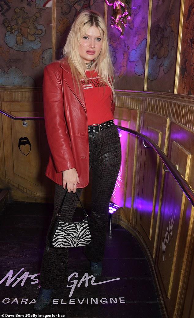 Clashing prints:Cassyette wore snakeskin trousers and had a zebra-print handbag