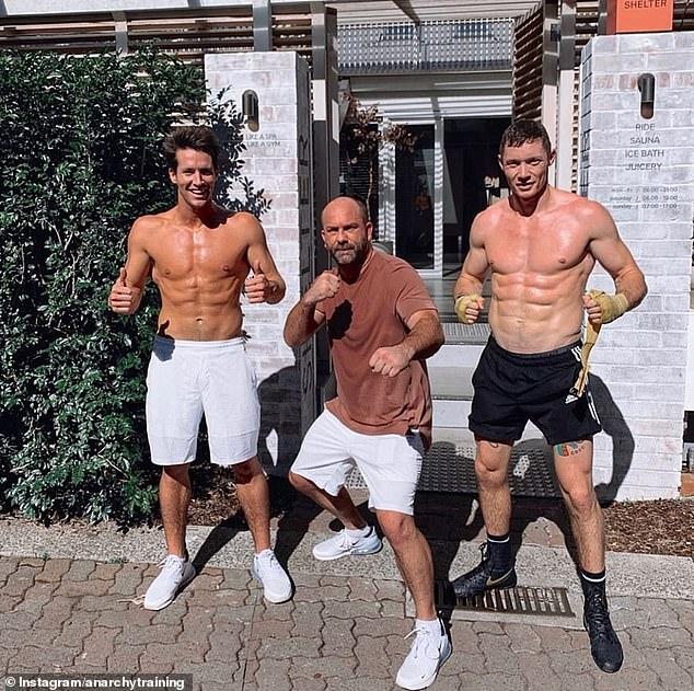 Former professional boxer and mixed martial arts fighter Glen Austin (pictured centre) said boxing is the best exercise to hone the perfect summer body