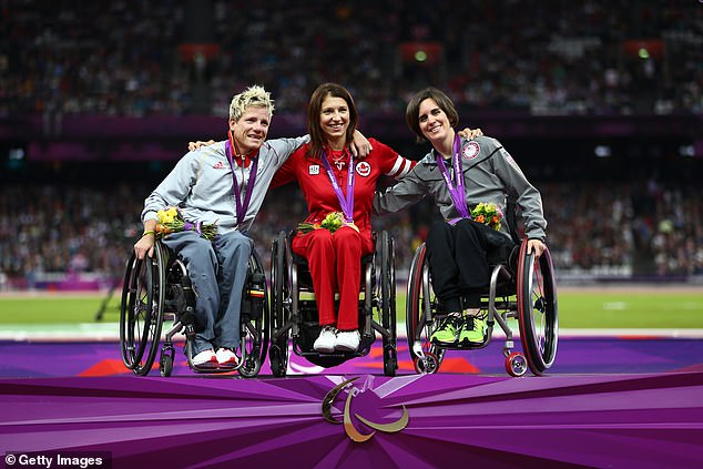 Vervoort's (left, withMichelle Stilwell of Canada and bronze medallist Kerry Morgan of the US in 2012) health problems began in 2000 when she was struck down by the rare disease, progressive tetraplegia, which paralysed her