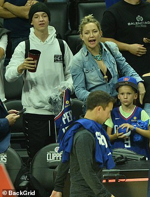 Side by side: The game proved to be a perfect bonding session for Kate and her oldest child as they watched the Clippers win by 112-102