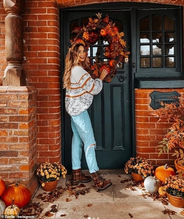In this image, Zoe Sugg shows off her new autumnal wreath - while inadvertently revealing what the front of her house looks like. The picture also clearly shows the type of lock and handle the door has, making it even easier for potential burglars to plan their entry