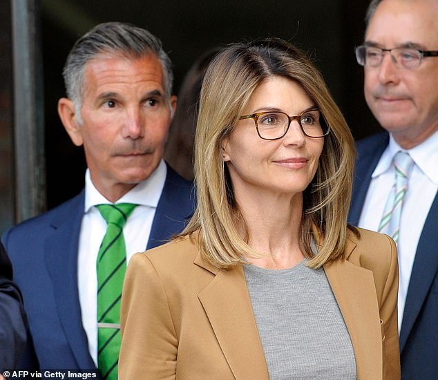 On Tuesday, the US District Attorney of Massachusetts announced that a grand jury had returned additional charges against 11 of the 15 parents charged in the college admissions case - including Loughlin and Giannulli (pictured in a file photo from April)