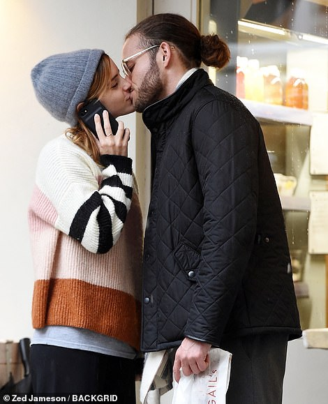 Who's that? Emma Watson shared a passionate kiss with a mystery man as she stepped out for lunch in London on Thursday