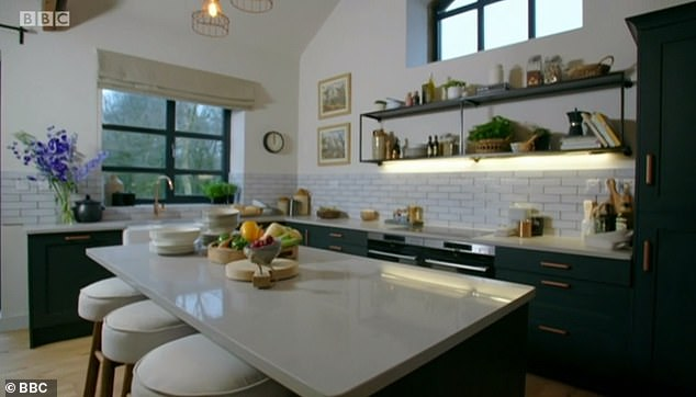 An entire modern kitchen was also added, with enough space for son Ben to get his wheelchair around the kitchen island. The worksurfaces were also lower so that he could access them