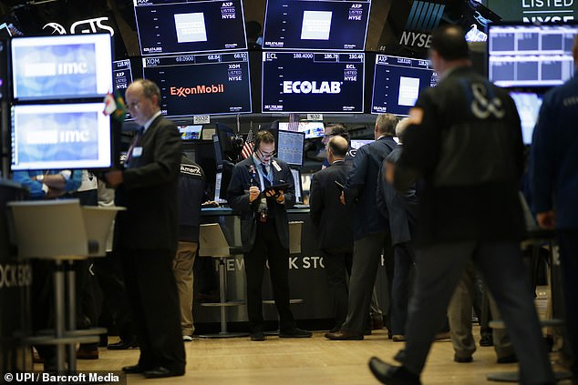 Tesla stock, traded on the NASDAQ (pictured) ended the day up 17.7 percent, closing at almost $300 a share, surprising analysts