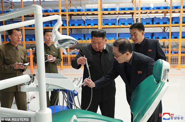 He inspects dentistry equipment at a time when Mr Chol released a statement which accused Washington of trying to 'isolate and stifle' North Korea in a 'more crafty and viscous way than before'
