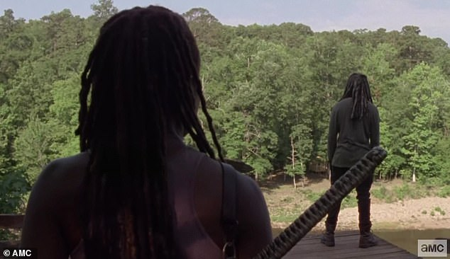 Low point: Ezekiel was found by Michonne as he stoodon a rickety platform in the woods, overlooking a ravine far below