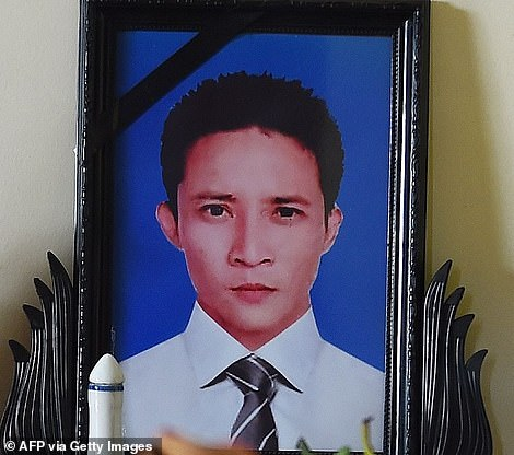 A picture of carpenter Le Van Hais kept on a prayer altar at his house in Vietnam's Nghe province