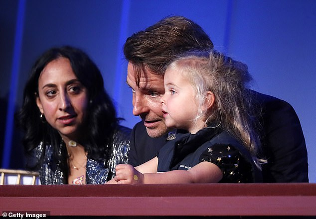Cute: The Hollywood star fussed over his adorable daughter while watching the televised ceremony