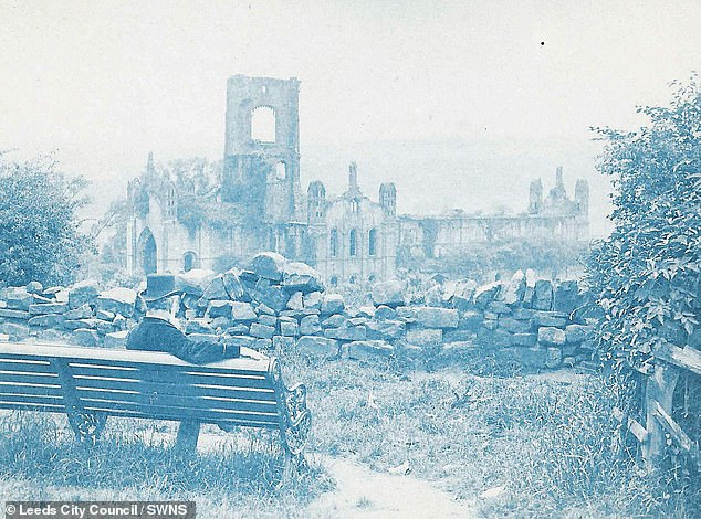 The black and white photo was taken by 19th century engineer Washington Teasdale in front of Kirkstall Abbey in 1883