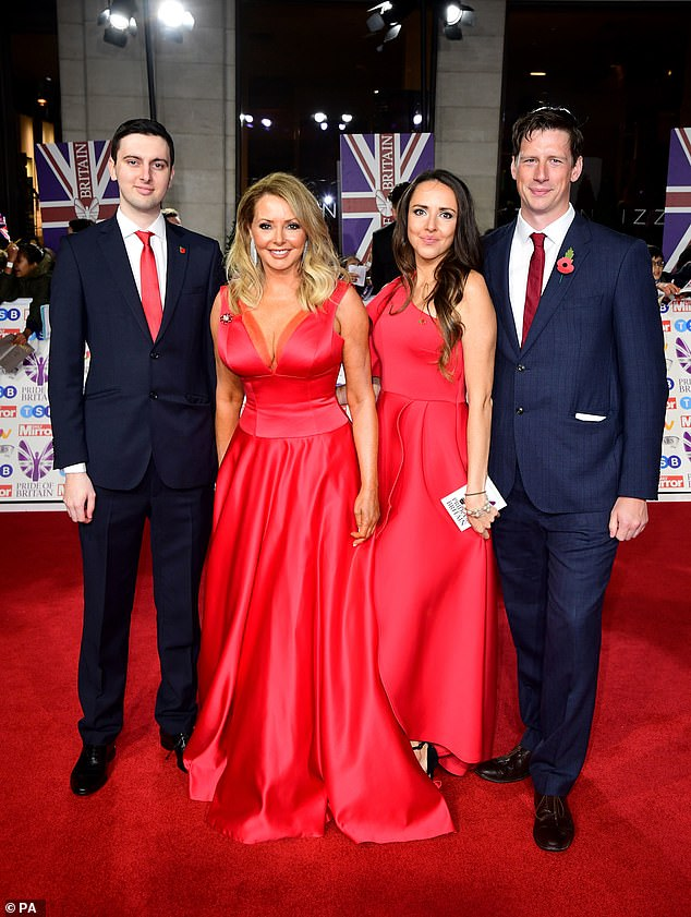 Wow! Carol Vorderman, 58, was joined by her children Cameron King, 22, (left) and Katie King, 28, as she arrived at the Pride of Britain Awards on Monday evening (pictured with a guest)